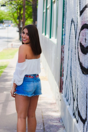 Top: Dainty Hooligan Cream Twisted Top Shorts: Forever 21